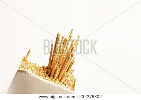 A Close Up Shot Of Wooden Tooth Picks With Several Pulled Out From Pack