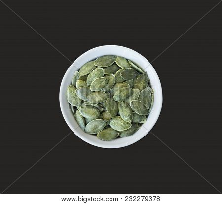 Pumpkin Seeds Isolated On Black Background. Top View. Pumpkin Seeds In A Bowl Isolated On Black Back