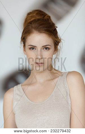 Portrait Of Attractive Tender Redhead Young Girl With Healthy Freckled Skin Wearing Casuail Simple C