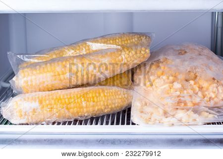 Frozen Corn In Bag In Freezer Close Up. Frozen Food