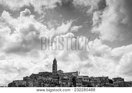 Monochrome Skyline Of Matera Town, A World Heritage Site In Southern Italy, With Rock Houses And Mon