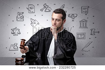 Handsome judge with court symbols around