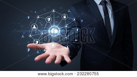 Businessman holding networking connection concept with dark wallpaper