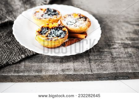 Egg Tart, Traditional Portuguese Dessert, Pastel De Nata On A Wooden Board