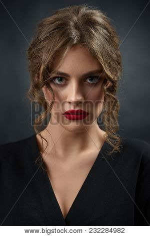 Portrait Of Young Beatiful Girl Wearing Black Fashionable Shirt And Bright Red Lipstick. Woman Havin