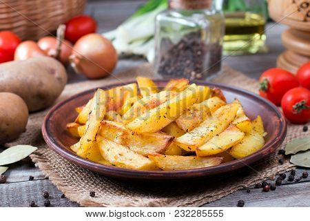 Roasted Potato Wedges With Herbs On A Plate In A Rustic Style
