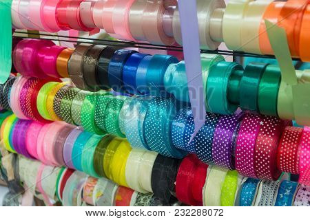 Colored Satin Ribbons On The Counter Of The Store. Needlework