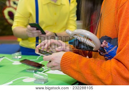 Hands Of The Buyer Choosing The Smartphone In Shop. Sales