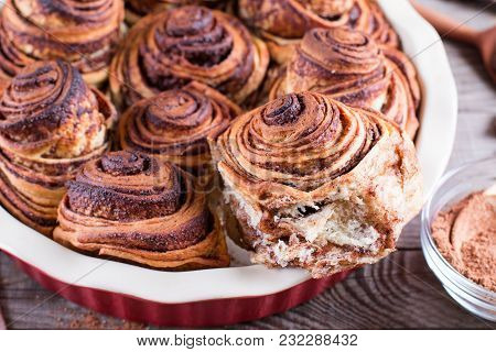 Cinnamon Buns With Chocolate Baked In Ceramic Form
