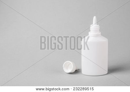 Spray For The Nose In A White Plastic Bottle On A Gray Background. Aerosol From The Common Cold Or A
