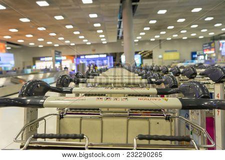 Visitors Walking In Arrival Hall At Suvarnabhumi International Airport