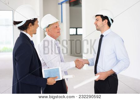 Confident Businessmen Concluding Deal On Construction Site And Shaking Hands As Symbol Of Partnershi