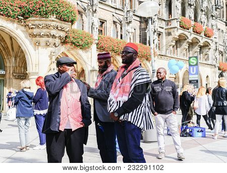 Munich, Germany - September 8 2017; Three Ethnic Black African Men In Group And Traditional Dress Ta