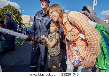 Kiev, Ukraine - Sept. 09, 2016: Young Boy Pretending To Be Firefighter And Learning How To Use Fire-