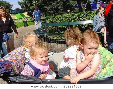 Close Up View Of Four Cute Barn In One Baby Pram On A Buss Station. Summer Day. Norway, Oslo. 07-20-