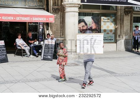 Munich, Germany - September 8 2017; Small Black Boy And Man Carrying Hand-written Sign On Protester