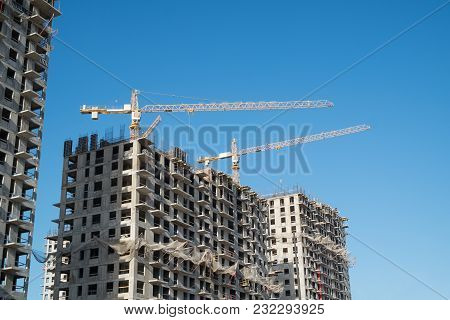 Construction site with a lot of incomplete buildings with cranes. Work in progress. New home in future poster