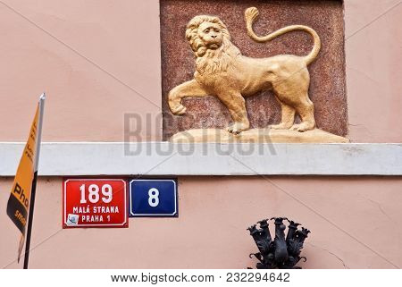 Image Of A Walking Lion On The Facade. Plates With House Numbers, Checkbox.