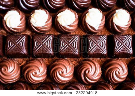 Assorted White, Milk And Dark Chocolate Sweets Background, Selective Focus