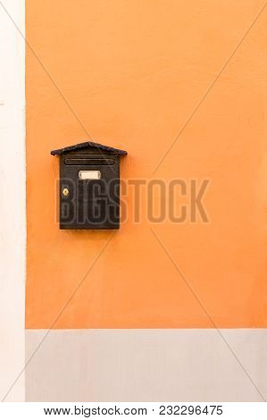 Vintage Brown Mail Box On Colorful Wall