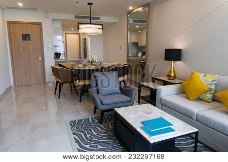 Modern Hotel Apartment With Combined Living Room And Kitchen. Comfortable Sofa And Armchair With Cof