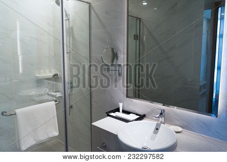 Hotel Bathroom With Shower Stall And Hanging Soft Towel On Handle. Modern Bathroom With Big And Smal