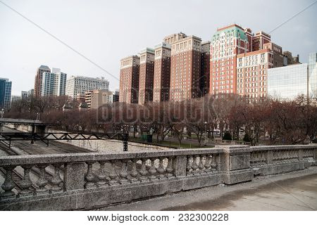 Buds Are Just Starting On The Trees That Line The Park Below Apartment Buildings And Offices In Chic