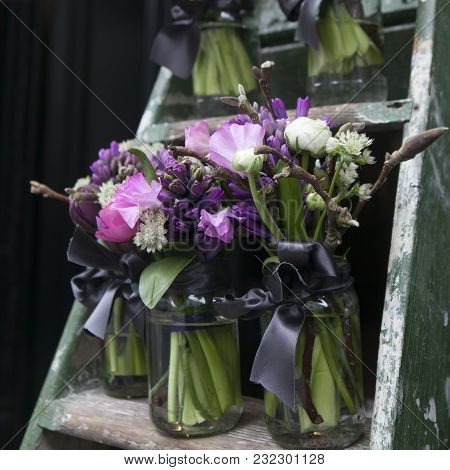 Decoration For Dining Table. Bouquet Of Blue Hyacinth In Vase Of Glass.