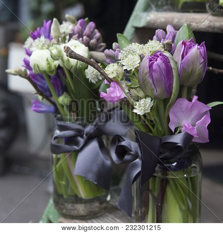 Decoration Of Dining Table. Bouquet Of Blue Hyacinth In Vase Of Glass.