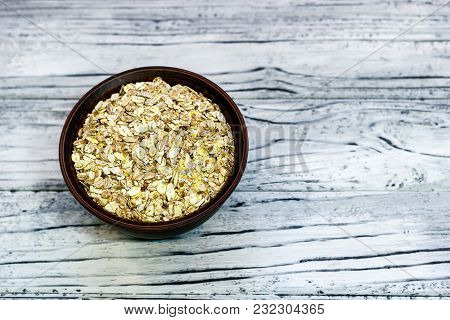 Plate With Muesli On A Wooden Background. Healthy Breakfast. Copy Space. View From Above.