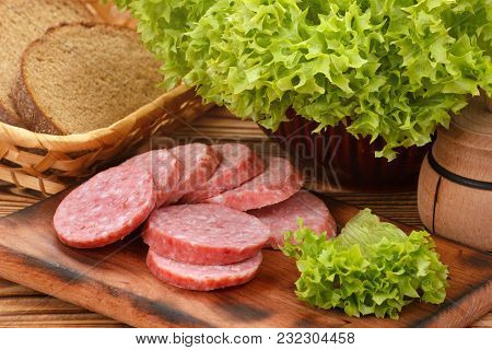Sliced Smoked Sausage With Green Salad And Bread