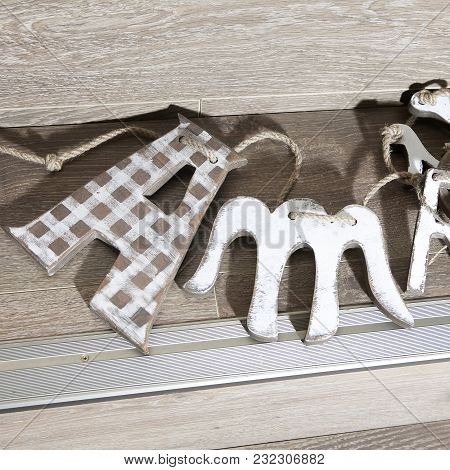 Wooden Letters On A Rope Lying On The Stairs