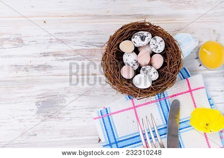 Decorative Eggs Sweets In The Nest And Easter Cake With Colorful Topping And Place Setting In Blue C