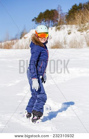 Full-length Picture Of Sporty Woman Wearing Helmet With Snowboard On Snowy Hill On Winter Day