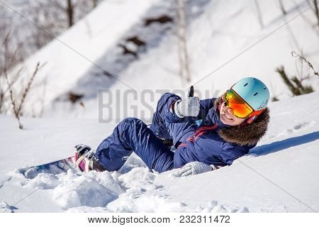 Photo From Back Of Athlete In Helmet Lying On Snowy Slope On Winter Day