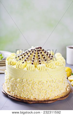 Lemon Layered Cake With Yellow Frosting Decorated With Chocolate