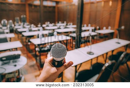 Close-up Microphone With Blurred People Attending Seminar Background