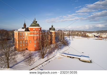 Aerial View During The Winter Season Of The Swedish Gripsholm Castle Located In Mariefred In The Pro