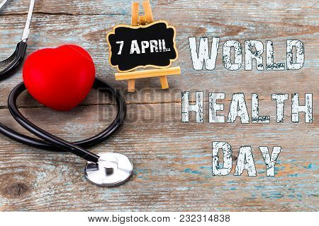 Stethoscope And Heart Symbol With Inscription World Health Day On Wooden Background.