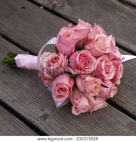 Wedding Pink Roses Lying On Wood Floor