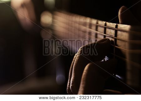 Man With Guitar, Male Hand Playing On Acoustic Guitar. Close-up.