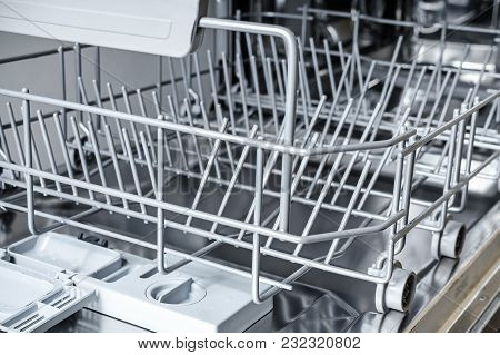 Empty Lower Basket In The Dishwasher, Close Up Photo