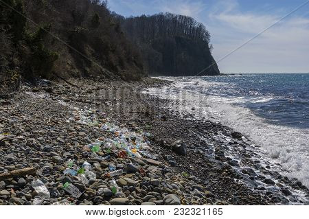 Pollutions And Garbages In The Sea And On The Beach
