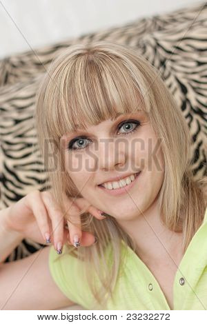The Girl Close Up Against Striped Pillows