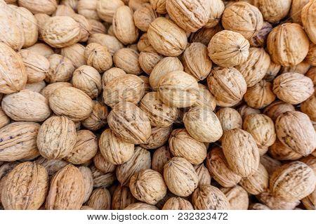 Lots Of European Walnuts In Peel, Natural Food Background, Healthy Food