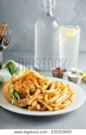 Po Boy Sandwich With Fried Shrimp And Fries