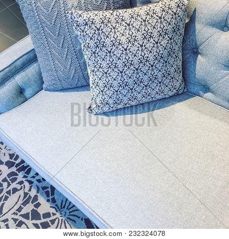Classic Style Sofa With Cushions In Wintery Gray Tones. Elegant Interior Design.