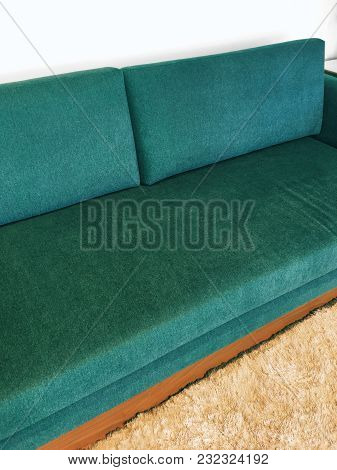 Retro Style Elegant Green Sofa And Fluffy Rug.