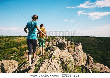 Girls With A Backpack Walk In Picturesque Places.