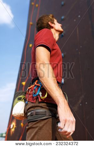 Close-up Detail Of Rock Climber Wearing Safety Harness And Climbing Equipment Outdoor Wich Chalk Mag